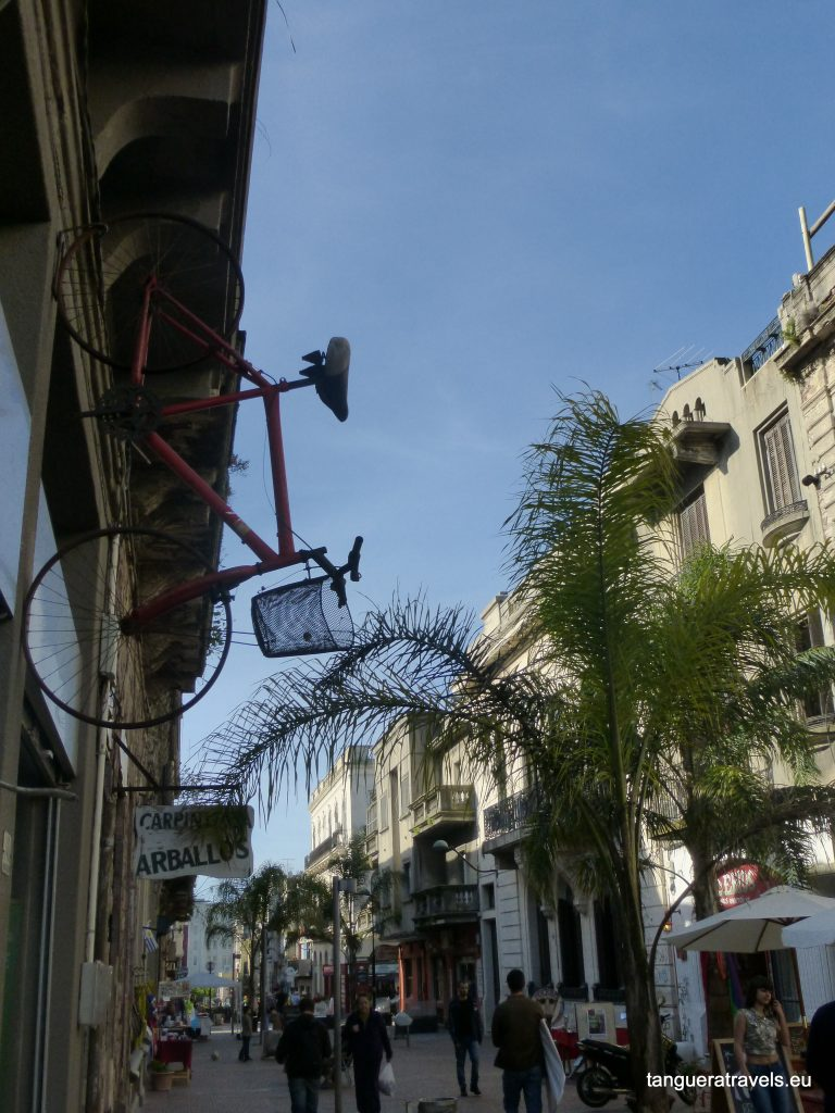 bicycle mounted to the side of a building in Montevideo