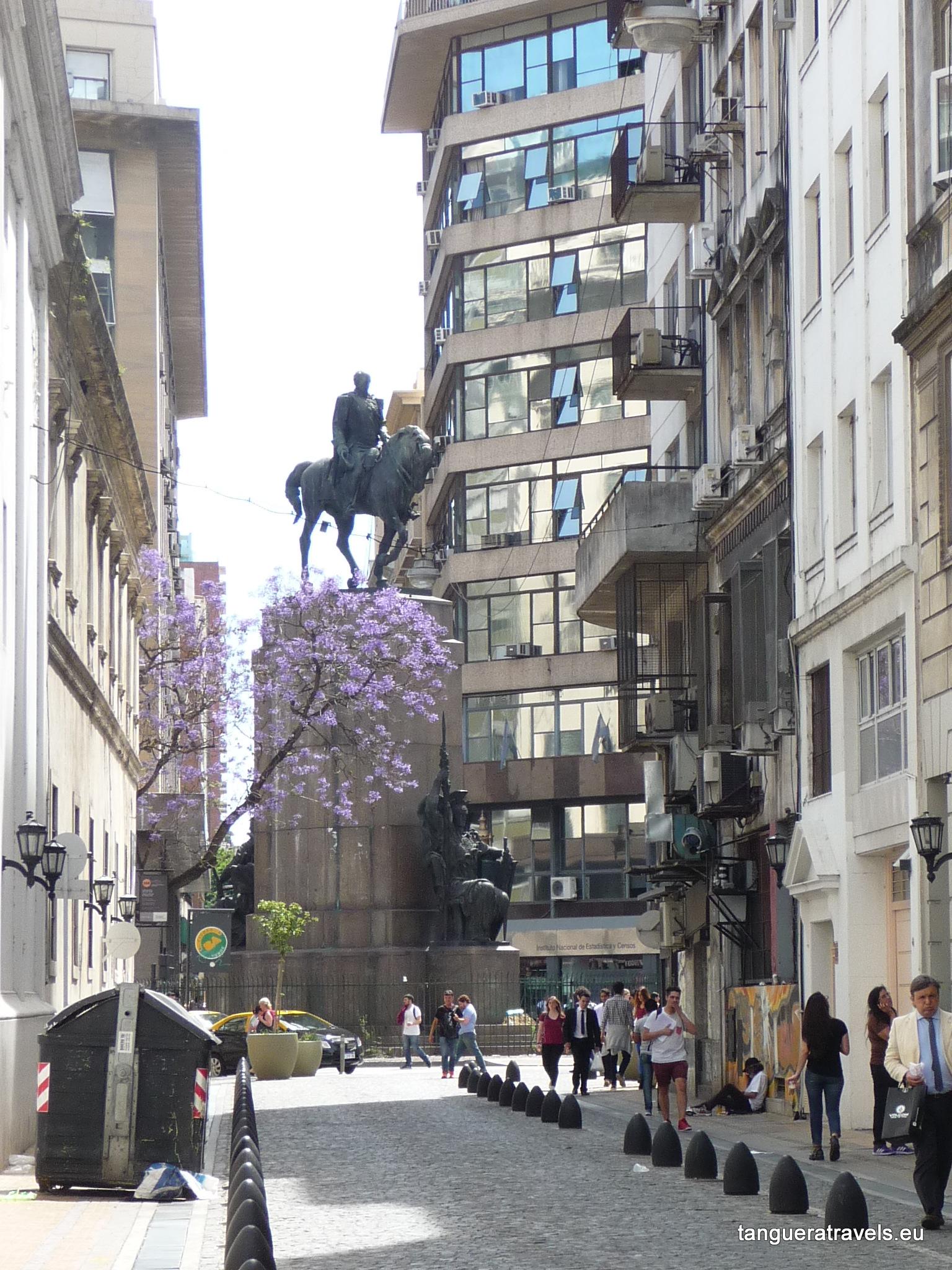 Statue carefully balances upon a tree
