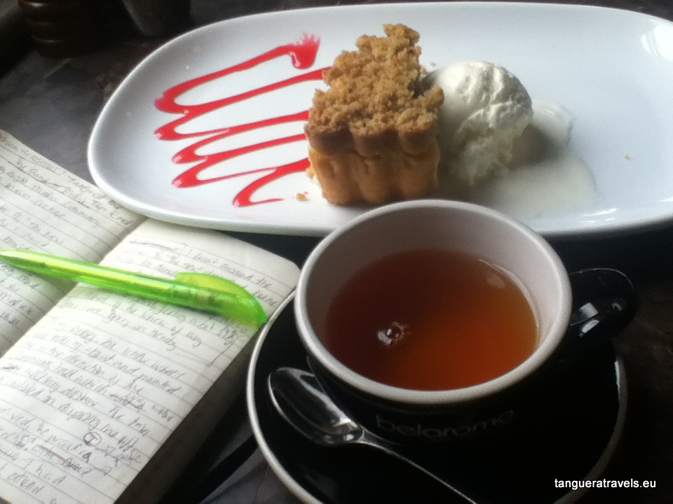 writing in a cafö: cake & tea & notebook